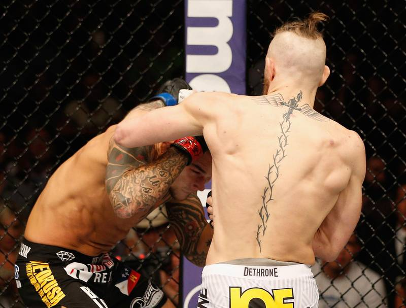 LAS VEGAS, NV - SEPTEMBER 27:  (R-L) Conor McGregor punches Dustin Poirier in their featherweight fight during the UFC 178 event inside the MGM Grand Garden Arena on September 27, 2014 in Las Vegas, Nevada.  (Photo by Josh Hedges/Zuffa LLC/Zuffa LLC via Getty Images)