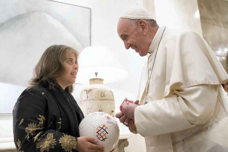 ABU DHABI, UNITED ARAB EMIRATES - February 4, 2019: Day two of the UAE papal visit -  His Holiness Pope Francis, Head of the Catholic Church(R), speaks with Special Olympics athlete, Sheikha Al Qassimi (L), after a reception at Al Mushrif Palace.  ( Ryan Carter / Ministry of Presidential Affairs ) ---