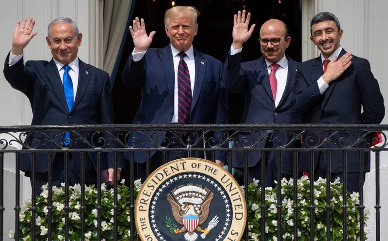 TOPSHOT - (L-R)Israeli Prime Minister Benjamin Netanyahu, US President Donald Trump, Bahrain Foreign Minister Abdullatif al-Zayani, and UAE Foreign Minister Abdullah bin Zayed Al-Nahyan wave from the Truman Balcony at the White House after they participated in the signing of the Abraham Accords where the countries of Bahrain and the United Arab Emirates recognize Israel, in Washington, DC, September 15, 2020. Israeli Prime Minister Benjamin Netanyahu and the foreign ministers of Bahrain and the United Arab Emirates arrived September 15, 2020 at the White House to sign historic accords normalizing ties between the Jewish and Arab states. / AFP / SAUL LOEB