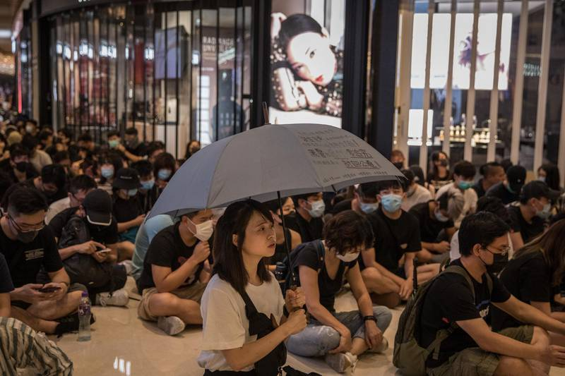 HONG KONG, CHINA - SEPTEMBER 21: Pro-democracy protesters sing songs and shout slogans as they gather in a shopping mall during a rally in Yeun Long district on September 21, 2019 in Hong Kong, China. Pro-democracy protesters have continued demonstrations across Hong Kong, calling for the city's Chief Executive Carrie Lam to immediately meet the rest of their demands, including an independent inquiry into police brutality, the retraction of the word riot to describe the rallies, and genuine universal suffrage, as the territory faces a leadership crisis. (Photo by Chris McGrath/Getty Images)