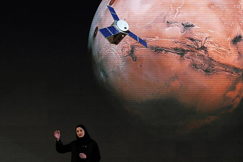 """Sarah Amiri, Deputy Project Manager of a planned United Arab Emirates Mars mission talks about the project named """"Hope"""" — or """"al-Amal"""" in Arabic — which is scheduled be launched in 2020, during a ceremony in Dubai, UAE, Wednesday, May 6, 2015. It would be the Arab world's first space probe to Mars and will take seven to nine months to reach the red planet, arriving in 2021. Emirati scientists hope the unmanned probe will provide a deeper understanding of the Martian atmosphere, and expect it to remain in orbit until at least 2023. (AP Photo/Kamran Jebreili)"""