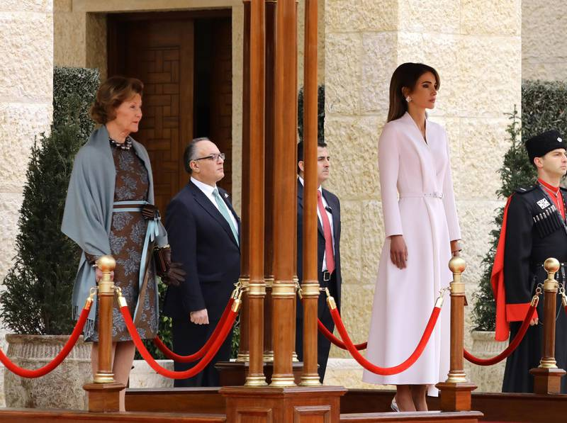 epa08264426 Queen Sonia of Norway (L) and Queen Rania of Jordan (R) look on as King Harald V of Norway and King Abdullah II of Jordan (both unseen) review the Guard of Honor, during the welcome ceremony at al-Husseiniya Palace in Amman, Jordan, 02 March 2020. The King and Queen of Norway arrived in Jordan on 01 March for a four-day official visit. In their first state visit to the Kingdom of Jordan, they are accompanied by a number of officials and an economic delegation.  EPA/AMEL PAIN