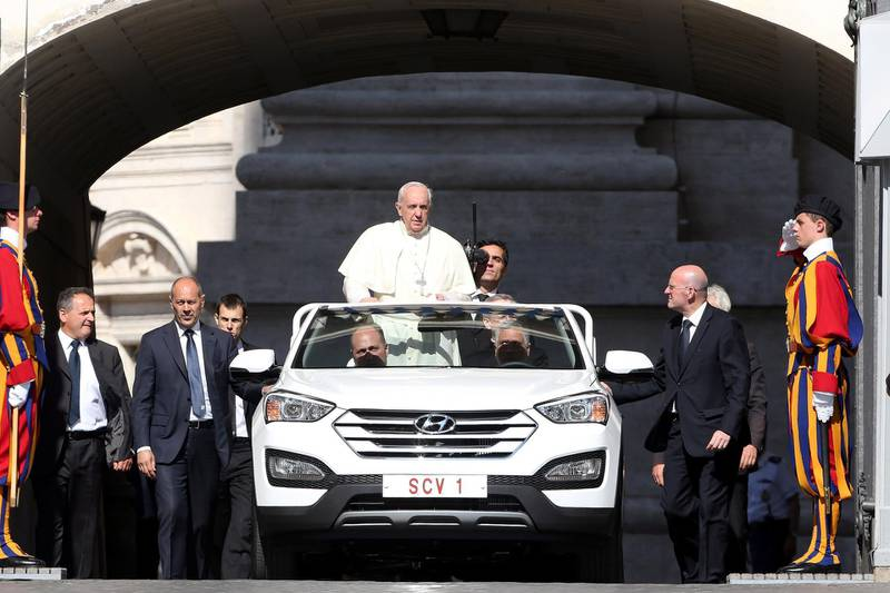 VATICAN CITY, VATICAN - JUNE 03:  Pope Francis arrives in St. Peter's square, with his new popemobile, for his weekly audience on June 3, 2015 in Vatican City, Vatican. Speaking during the weekly General Audience, the Pope continued his catechesis on the family opening up his reflections to a new perspective: the difficulties and problems that put families to the test in modern society.  (Photo by Franco Origlia/Getty Images)