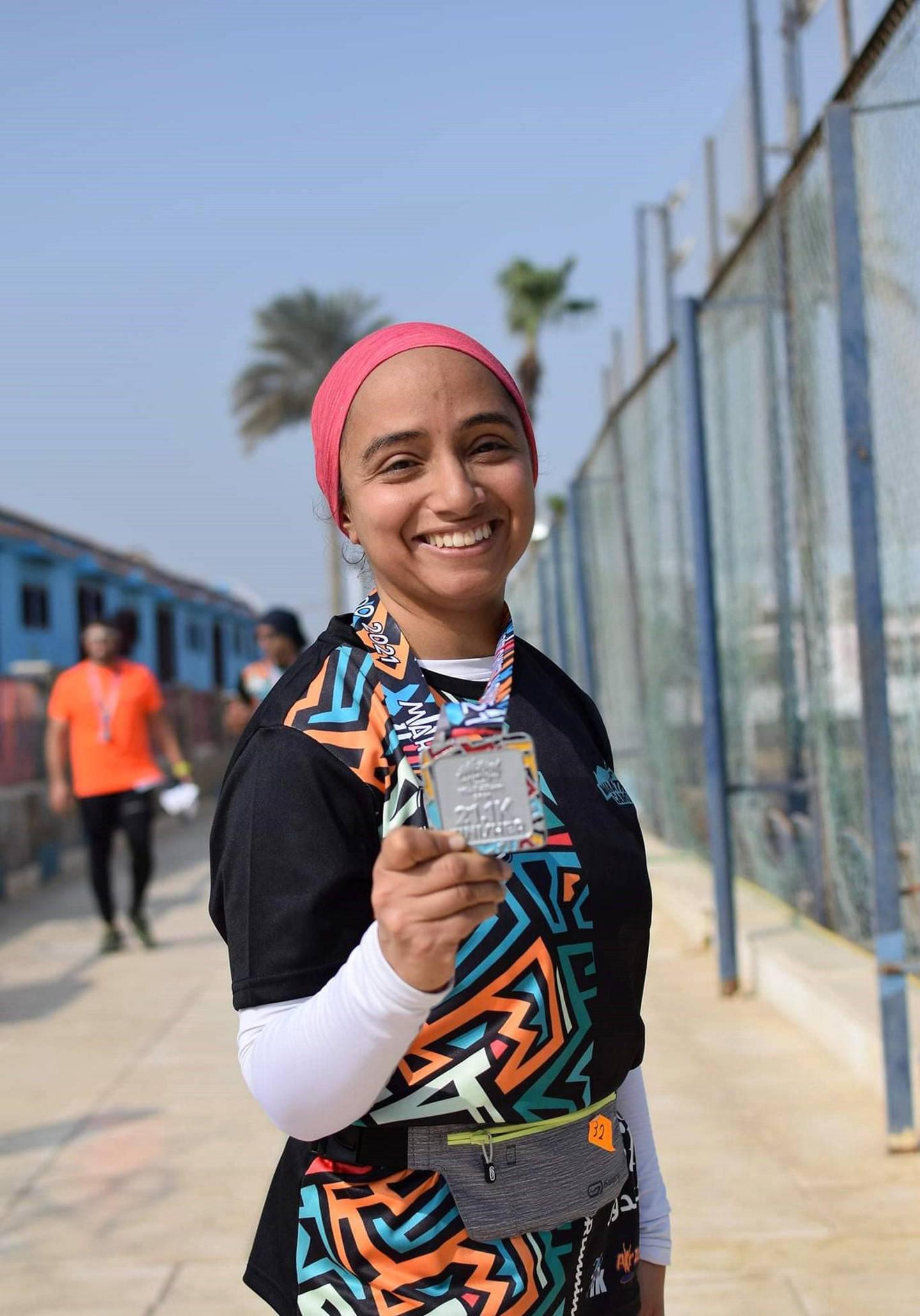 Aya Ayman with her half marathon medal. Courtesy Marathon Cairo