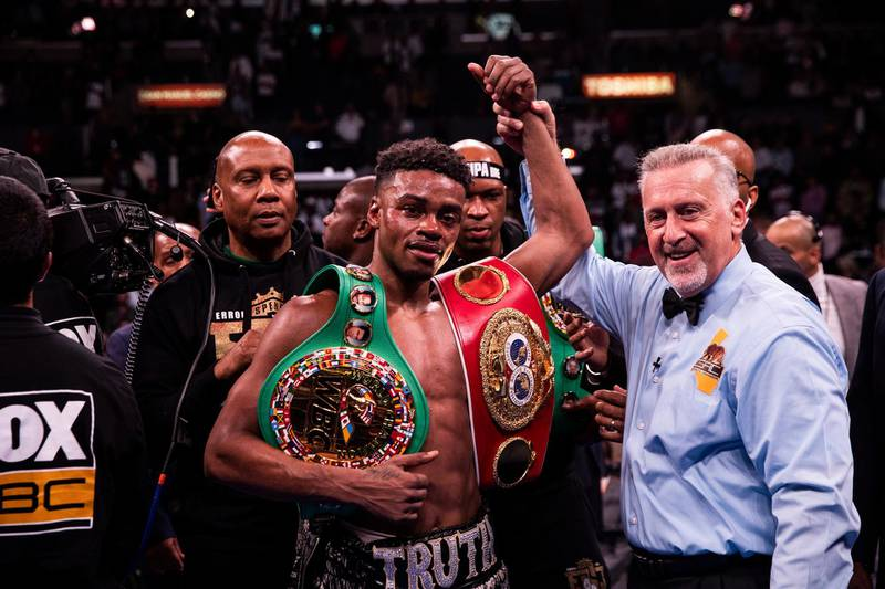 epa07878670 Errol Spence Jr. (C) of the USA celebrates after winning against Shawn Porter of the USA during their WBC and IBF World Welterweight Championship fight at Staples Center in Los Angeles, California, USA, 28 September 2019.  EPA/FRANCK BACHINI