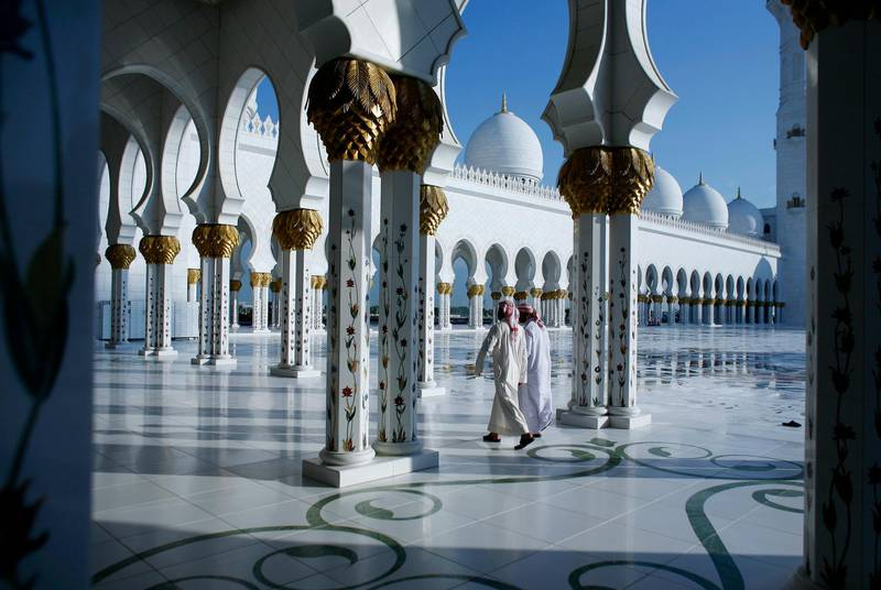 ABU DHABI, UNITED ARAB EMIRATES - December 6, 2008: Men leave the wet grounds of Sheikh Zayed Grand Mosque in Abu Dhabi after a unique prayer for rain at approximately 8:00am this morning. The President of the UAE, His Highness Sheikh Khalifa bin Zayed Al Nahyan called for a country wide prayer for rain.( Ryan Carter / The National )  *** Local Caption ***  RC005-RainPrayer.JPGRC005-RainPrayer.JPG