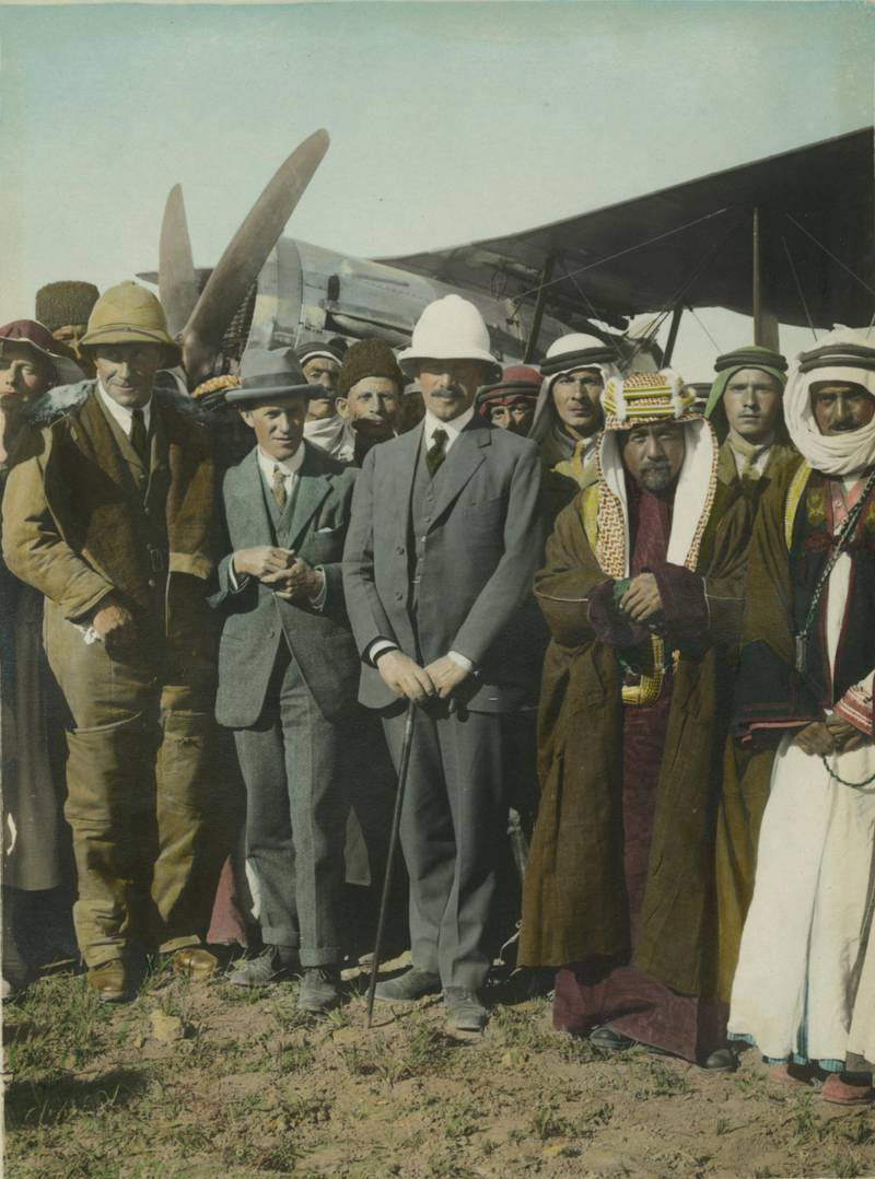 On the Aerodrome at Amman. Col. Laurence [T.E. Lawrence]. Sir Herbert Samuel. Amir Abdullah. April, 1921. [Gertrude Bell (?) at left and Sheik Majid Pasha el Adwan at far right]. Meetings of British, Arab, and Bedouin officials in Amman, Jordan, April. Courtesy Library of Congress, Prints & Photographs Division
