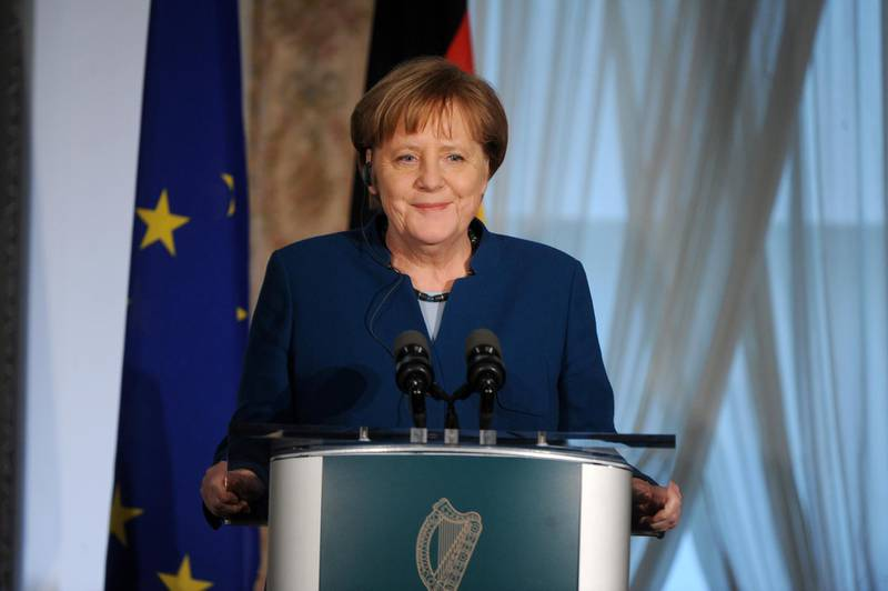 epa07485277 German Chancellor Angela Merkel (L) smiles during a press conference with Irish Prime Minister An Taoiseach Leo Varadkar (R), in Farmleigh, Dublin, Ireland, 04 April 2019. Both leaders discussed the possible second extension of article 50 requested by British Prime Minister May.  EPA/AIDAN CRAWLEY