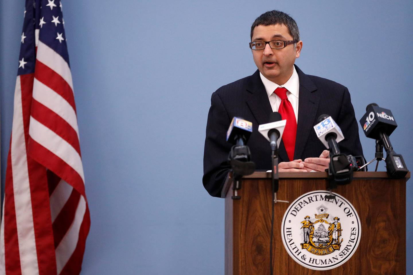 Dr. Nirav Shah, director of the Maine Center for Disease Control and Prevention, speaks at a news conference Monday, March 16, 2020, in Augusta, Maine. Shah announced that there are five new cases of coronavirus, bringing the total in Maine to 17. (AP Photo/Robert F. Bukaty)