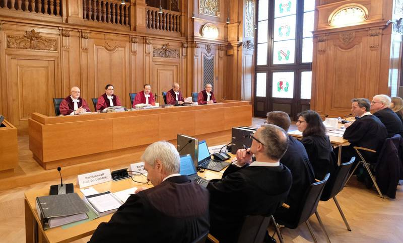 """Judges and lawyers sit at the beginning of the hearing in a hall of the Federal Administrative Court on February 22, 2018 in Leipzig, eastern Germany, where the court possibly will deliver a verdict on the legality of banning driving diesel cars when pollution reaches high levels. Since Volkswagen admitted in 2015 to installing software to fool regulatory emissions tests in millions of cars worldwide -- the so-called """"dieselgate"""" scandal --  nitrogen oxide (NOx) and fine particle emissions from diesel motors have been the top priority for German environmentalists. / AFP PHOTO / dpa / Sebastian Willnow / Germany OUT"""