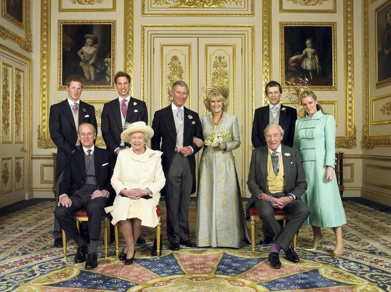 (EMBARGOED TO 0001 BST MONDAY APRIL 11 2005) WINDSOR, ENGLAND - APRIL 9: Clarence House official handout photo of the Prince of Wales and his new bride Camilla, Duchess of Cornwall, with their families (L-R back row) Prince Harry, Prince William, Tom and Laura Parker Bowles (L-R front row) Duke of Edinburgh, Britain's Queen Elizabeth II and Camilla's father Major Bruce Shand, in the White Drawing Room at Windsor Castle after their wedding ceremony, April 9, 2005 in Windsor, England. (Photo by Hugo Burnand/Pool/Getty Images)