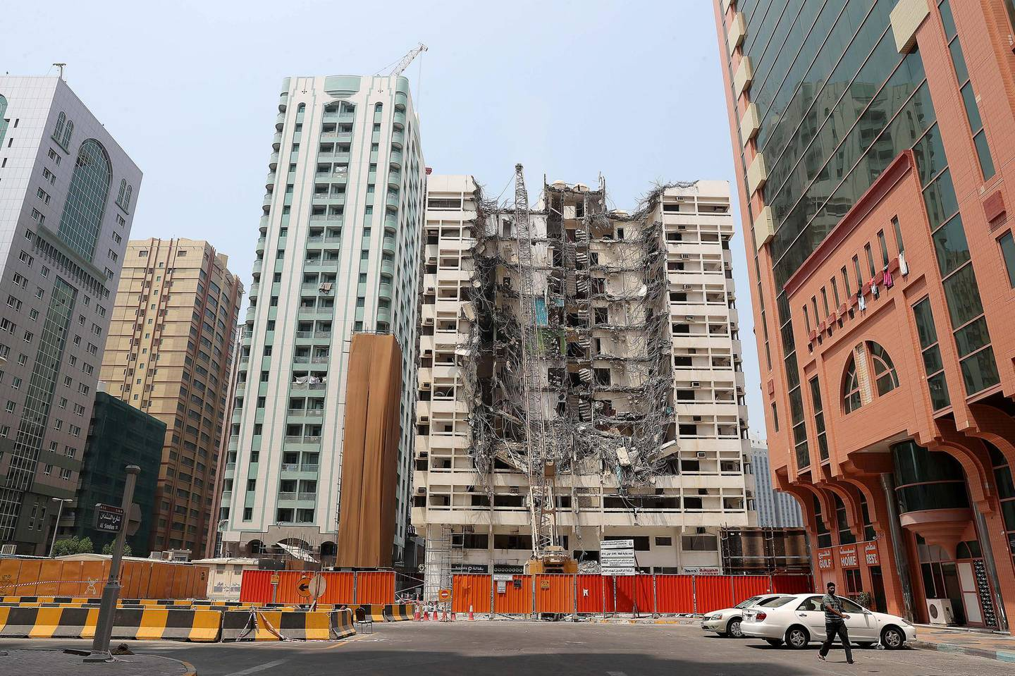 ABU DHABI , UNITED ARAB EMIRATES, September 9 – 2018 :- Demolition of one of the old building is going on at the Tourist Club area in Abu Dhabi. ( Pawan Singh / The National )  For News. Story by Anna/ John