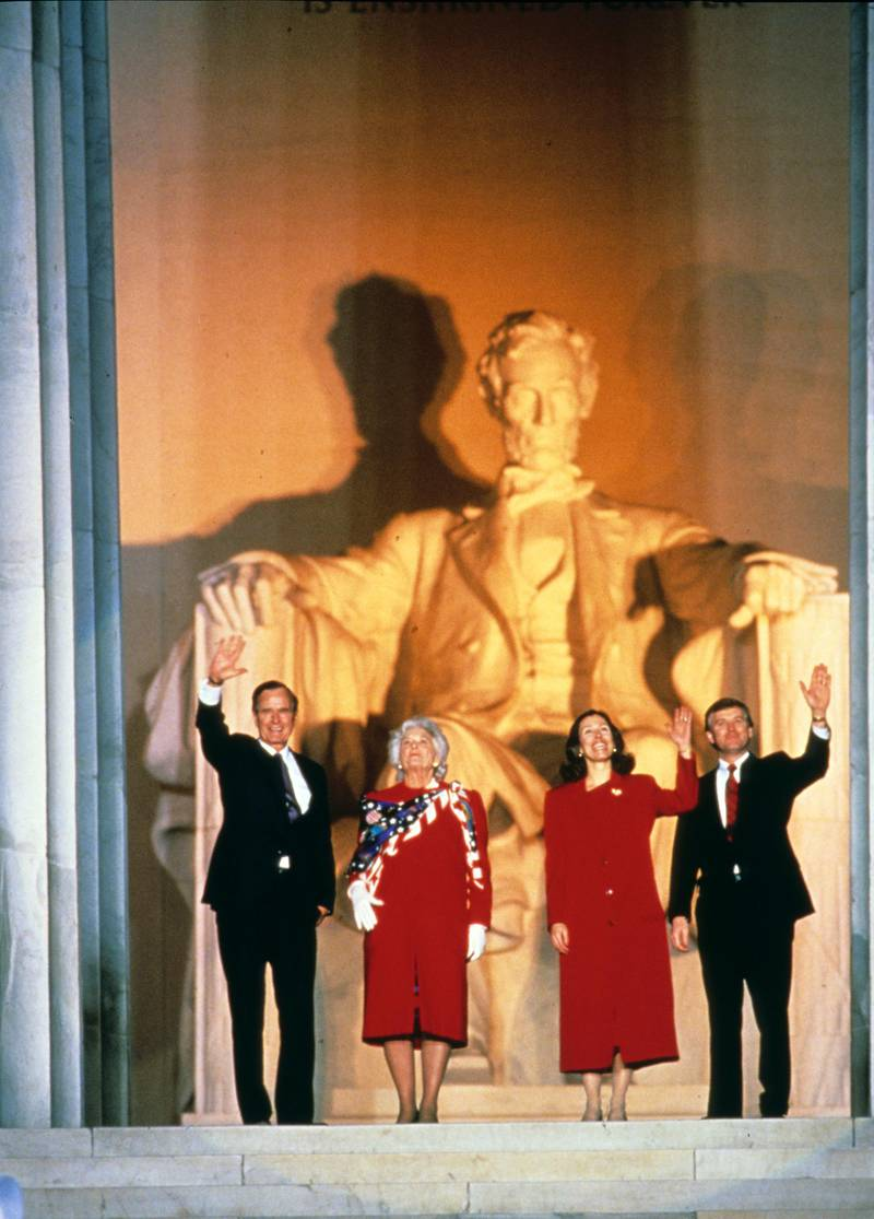 At the Lincoln Memorial, US President-Elect George HW Bush (left) and Vice President-Elect Dan Quayle (right), along with their wives, Barbra Bush (center left) and Marilyn Quayle, wave during their inaugural opening ceremony, Washington DC, January 18, 1989. (Photo by Robert Trippett/Consolidated News Pictures/Getty Images)