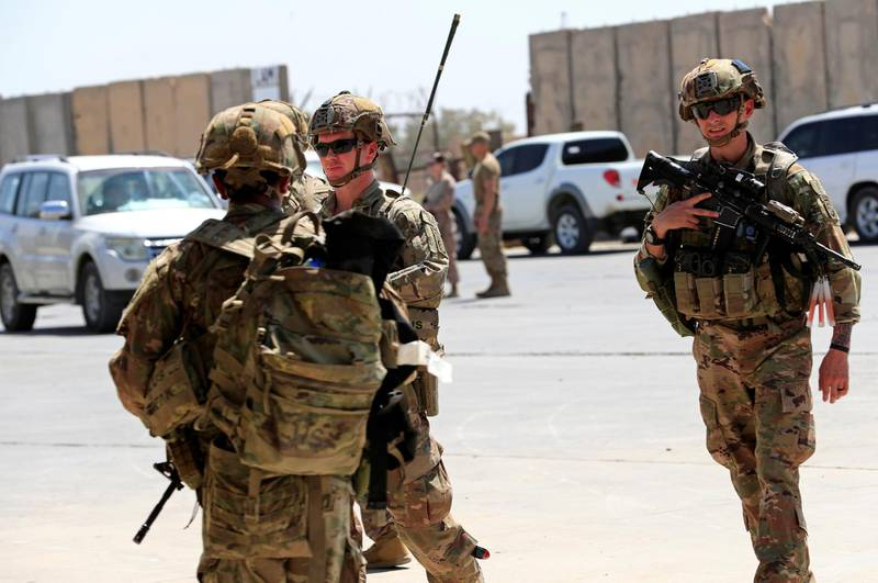 U.S. soldiers are seen during a handover ceremony of Taji military base from US-led coalition troops to Iraqi security forces, in the base north of Baghdad, Iraq August 23, 2020. REUTERS/Thaier Al-Sudani