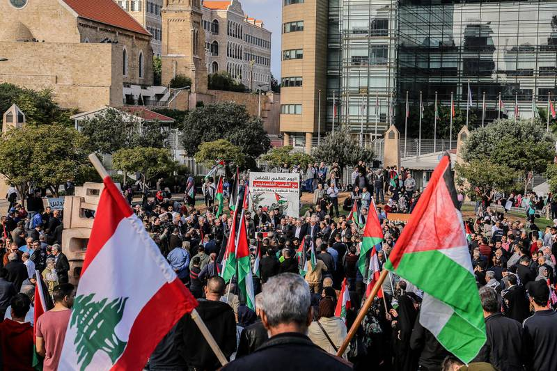 epa07199561 Palestinian and Lebanese wave national flags during a gathering of Lebanese national parties and Palestinian factions to mark the 'International Day of Solidarity with the Palestinian People and Support for the Resistance and Refusal to Normalize', in the Gibran Khalil Gibran Park - in front of the ESCWA building in Beirut, Lebanon, 30 November 2018. The UN General Assembly declared 29 November of each year a day of solidarity with the Palestinian people since 1977, in which it renounced its decision number 181 to partition Palestine, and took into account the legitimate national rights of the Palestinian people, namely, the establishment of an independent Palestinian state and return and self-determination.  EPA/NABIL MOUNZER