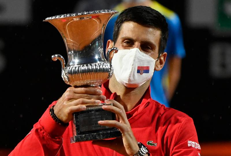 Tennis - ATP Masters 1000 - Italian Open - Foro Italico, Rome, Italy - September 21, 2020 Serbia's Novak Djokovic celebrates with the trophy after winning the final against Argentina's Diego Schwartzman Pool via REUTERS/Riccardo Antimiani