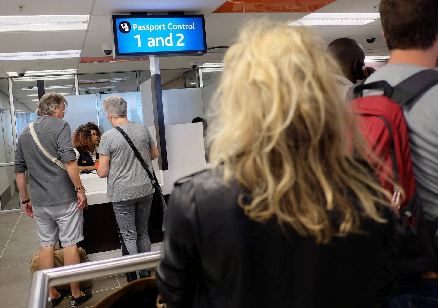 Passengers wait for passport control at Cape Town International Airport in Cape Town, South Africa, January 12, 2018. Picture taken January 12, 2018. REUTERS/Hannah McKay