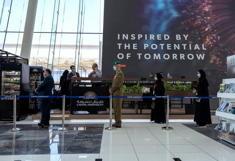 Abu Dhabi, United Arab Emirates, February 24, 2021.  Idex 2021 Day 4.Exhbition visitors practice social distancing while lining up for coffee.Victor Besa / The NationalSection:  NA