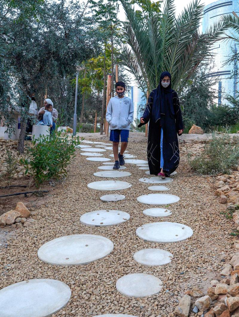Abu Dhabi, United Arab Emirates, January 21, 2021.  One of the many walkways in Al Fay Park on Reem Island. Victor Besa/The National  Section:  LF Reporter: Panna Munyal