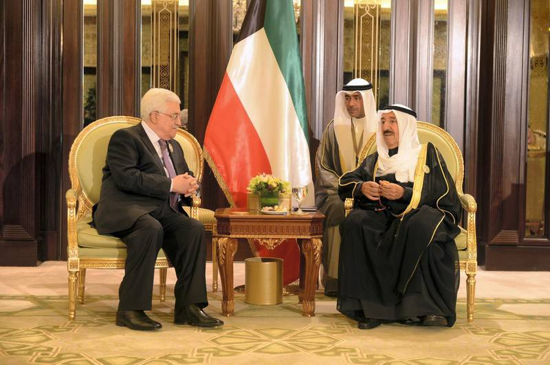 KUWAIT CITY, KUWAIT - NOVEMBER 19: In this handout photo provided by the PPO, Palestinian President Mahmoud Abbas (L) meets with Emir of Kuwait Sabah Al-Ahmad Al-Jaber Al-Sabah during the Arab-African Summit November 19, 2013 in Kuwait City, Kuwait. Leaders gathered for the two-day summit to discuss economic ties between Africa and the Gulf. (Photo by Thaer Ghanaim/PPO via Getty Images)