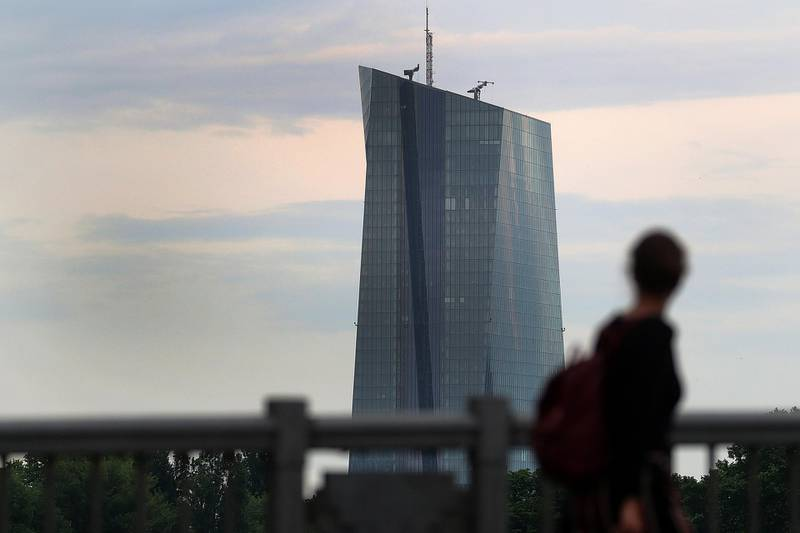 A pedestrian looks towards the European Central Bank (ECB) skyscraper headquarters in Frankfurt, Germany, on Wednesday, May 23, 2018. Frankfurt has emerged as the biggest winner in the fight for thousands of London-based jobs that will have to be relocated to new hubs inside the European Union after Brexit. Photographer: Krisztian Bocsi/Bloomberg