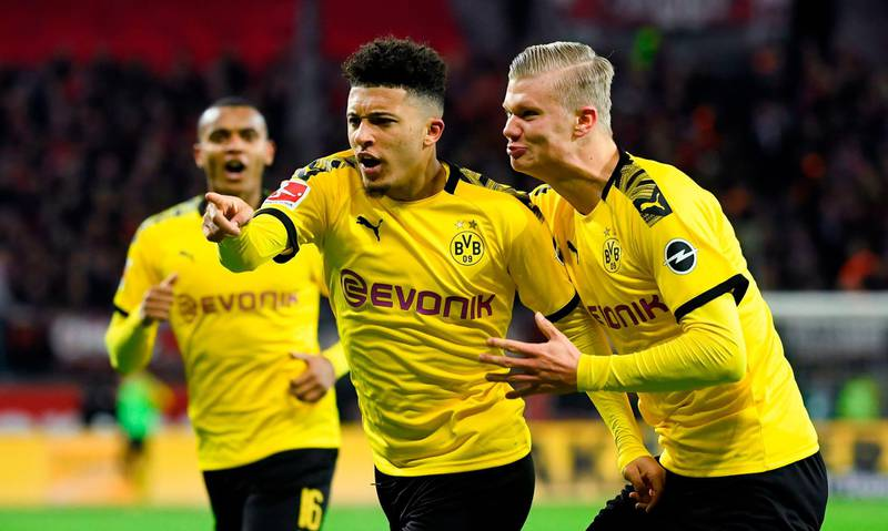 (L-R) Dortmund's Swiss defender Manuel Akanji, Dortmund's English forward Jadon Sancho and Dortmund's Norwegian forward Erling Braut Haaland celebrate a goal that was cancelled by VAR during the German first division Bundesliga football match Bayer 04 Leverkusen vs BVB Borussia Dortmund in Leverkusen, western Germany on February 8, 2020.  - RESTRICTIONS: DFL REGULATIONS PROHIBIT ANY USE OF PHOTOGRAPHS AS IMAGE SEQUENCES AND/OR QUASI-VIDEO   / AFP / INA FASSBENDER / RESTRICTIONS: DFL REGULATIONS PROHIBIT ANY USE OF PHOTOGRAPHS AS IMAGE SEQUENCES AND/OR QUASI-VIDEO
