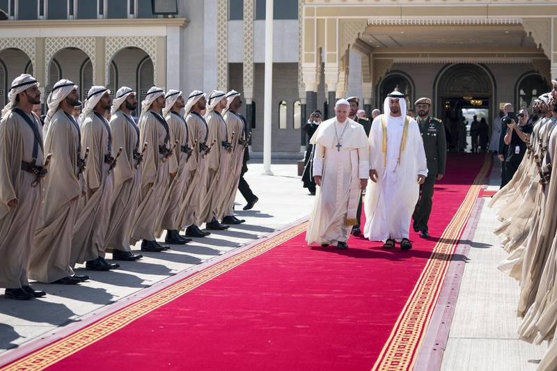 ABU DHABI, UNITED ARAB EMIRATES - February 05, 2019: Day three of the UAE Papal visit - HH Sheikh Mohamed bin Zayed Al Nahyan, Crown Prince of Abu Dhabi and Deputy Supreme Commander of the UAE Armed Forces (R), bids farewell to His Holiness Pope Francis, Head of the Catholic Church (L), at the Presidential Airport.    ( Mohamed Al Hammadi / Ministry of Presidential Affairs ) ---