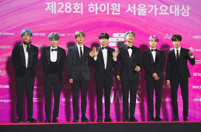 """(FILES) In this file photo South Korean boy band BTS, also known as the Bangtan Boys, pose on the red carpet at the 28th Seoul Music Awards in Seoul on January 15, 2019. Legions of K-pop fans and TikTok users are taking credit for upending Donald Trump's weekend rally after block-reserving tickets with no intention to attend an event that was beset by an embarrassingly low turnout. / AFP / Jung Yeon-je / TO GO WITH AFP STORY by Maggy DONALDSON: """"Online disruption of Trump rally highlights K-pop's political hustle"""""""