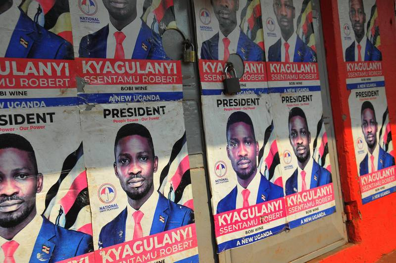 epa08934989 Election posters for presidential candidate Robert Kyagulanyi Ssentamu otherwise known as Bobi Wine adorn a locked store front in the capital Kampala a day ahead of the presidential elections in Uganda, 13 January 2021. The Ugandan presidential elections are due to take place on 14 January 2021, with Bobi Wine emerging as the top opposition challenger against incumbent Ugandan president Yoweri Kaguta Museveni, who has been President since 1986. President Yoweri Museveni has ordered the shutdown of some social media and messaging apps including Facebook ahead of the election.  EPA/STR