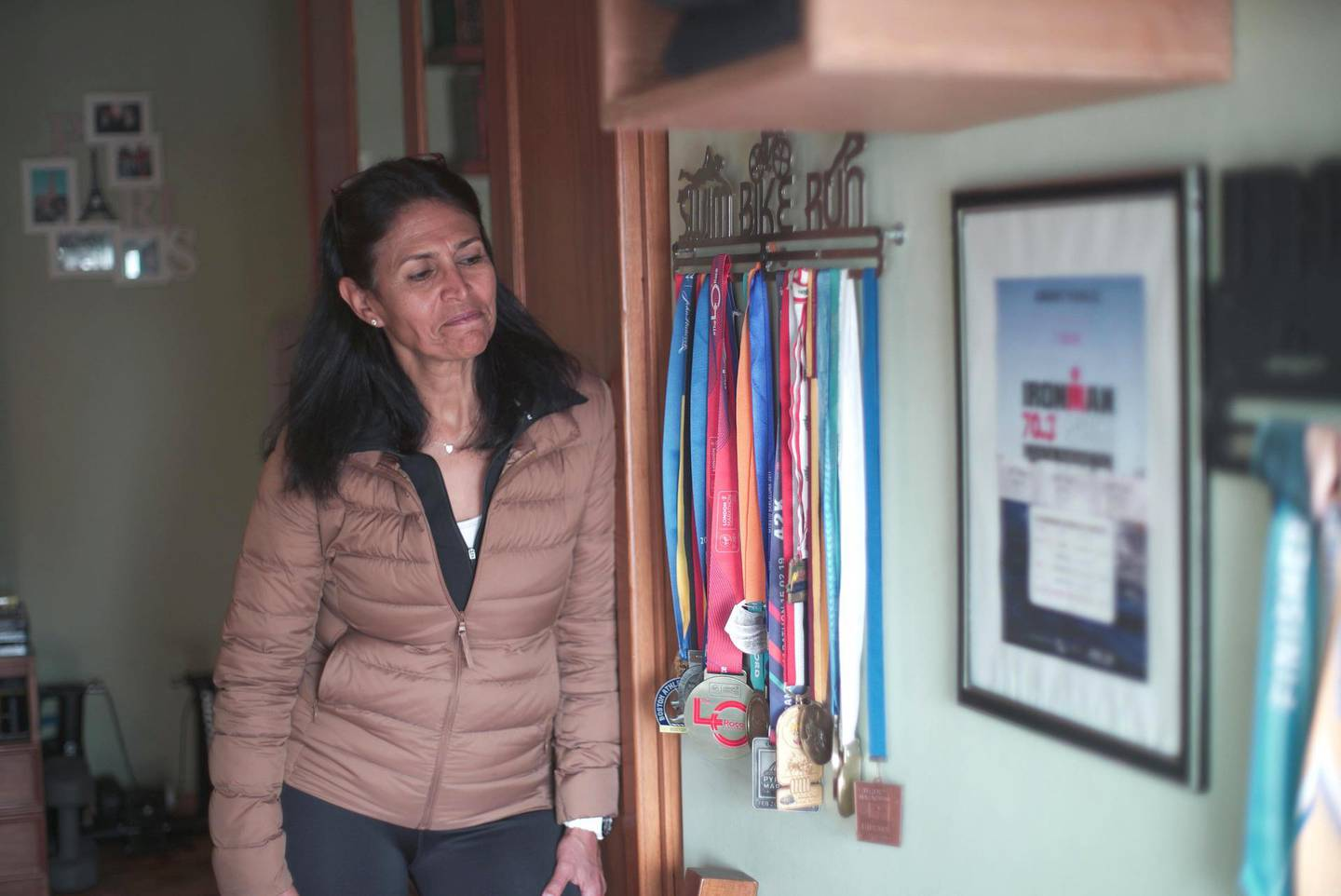 Amany Khalil with her marathon and triathlon medalsMahmoud Nasr / The National