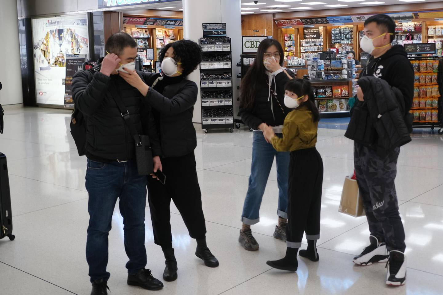 NEW YORK, NEW YORK - JANUARY 31: At the terminal that serves planes bound for China, people wear medical masks at John F. Kennedy Airport (JFK) out of concern over the Coronavirus on January 31, 2020 in New York City. The virus, which has so far killed over 200 people and infected an estimated 9,900 people, is believed to have started in the Chinese city of Wuhan.   Spencer Platt/Getty Images/AFP == FOR NEWSPAPERS, INTERNET, TELCOS & TELEVISION USE ONLY ==