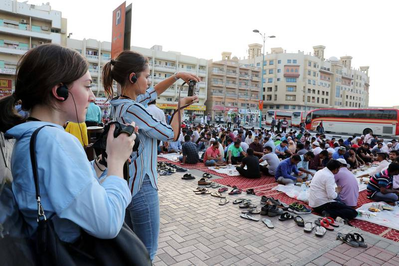 DUBAI , UNITED ARAB EMIRATES , MAY 23 – 2018 :- Participants taking photos during the iftar at the mosque near Al Ghubaiba bus station during the Unseen Trails Iftar Walk presented by Gulf Photo Plus and Frying Pan Adventures in Bur Dubai area in Dubai.  ( Pawan Singh / The National )  For Weekender