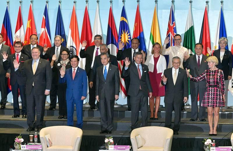Representatives attending the 25th ASEAN Regional Forum Retreat pose for a group photograph in Singapore, Saturday, Aug. 4, 2018. (AP Photo/Joseph Nair)