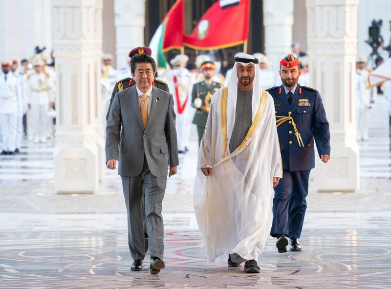 ABU DHABI, UNITED ARAB EMIRATES - January 13, 2020: HH Sheikh Mohamed bin Zayed Al Nahyan, Crown Prince of Abu Dhabi and Deputy Supreme Commander of the UAE Armed Forces (R), hosts a reception for HE Shinzo Abe, Prime Minister of Japan (L), at Qasr Al Watan.  ( Hamad Al Kaabi / Ministry of Presidential Affairs ) ---