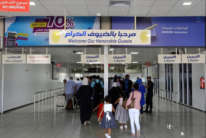 Travellers arrive at the Mitiga International Airport after its reopening on September 7, 2018, in the Libyan capital of Tripoli. (Photo by Mahmud TURKIA / AFP)