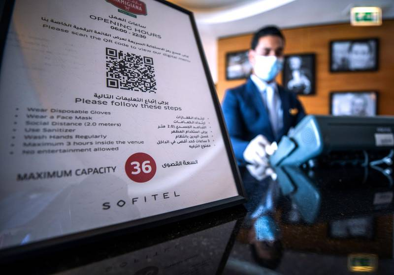 Abu Dhabi, United Arab Emirates, July 12, 2020.   Sofitel Abu Dhabi Corniche Hotel with updated Covid-19 precautionary measures.  A maximum capacity sign located at the reception of the Parmigiana Italian Restaurant.Victor Besa  / The NationalSection:  StandaloneReporter: