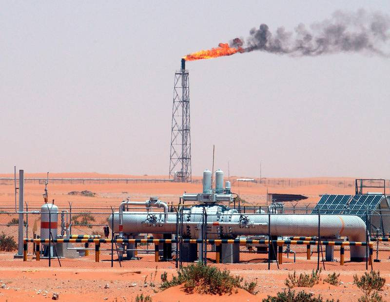 epa07569526 (FILE) - An image showing a gas flame behind pipelines in the desert at Khurais oil field, about 160 km from Riyadh, Kingdom of Saudi Arabia, 23 June 2008 (reissued 14 May 2019). Reports on 14 May 2019 state Saudi Aramco said some of its oil infrastructure in Saudi Arabia's eastern province has been attacked, including one of its petroleum pumping stations that was targeted by apparent armed drone attack.  EPA/ALI HAIDER *** Local Caption *** 90020213