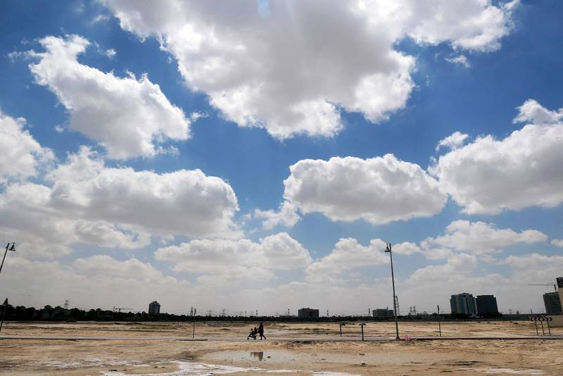 DUBAI, UNITED ARAB EMIRATES , March 24 – 2020 :- One of the lady walking with her kids during the cloudy sky in Al Furjan area in Dubai. People are staying home as a preventive measure against coronavirus in Dubai. (Pawan Singh / The National) For News/Online/Instagram/Big Picture/Standalone