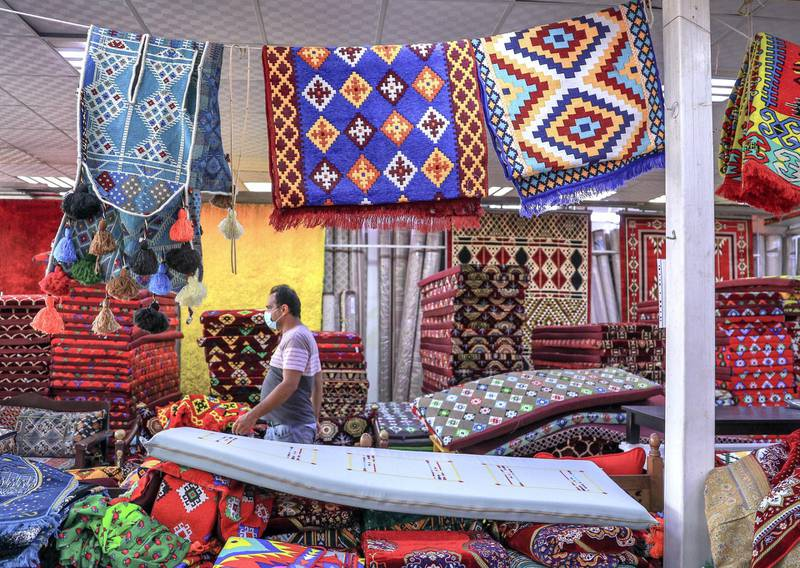 Abu Dhabi, United Arab Emirates, November 11, 2020.  Shop owners in Mina Zayed for a piece on how their shops will soon be demolished and replaced by new markets.  The Dar Al Ain pillows and mats section.Victor Besa/The NationalSection:  NAReporter:  Haneen Dajani