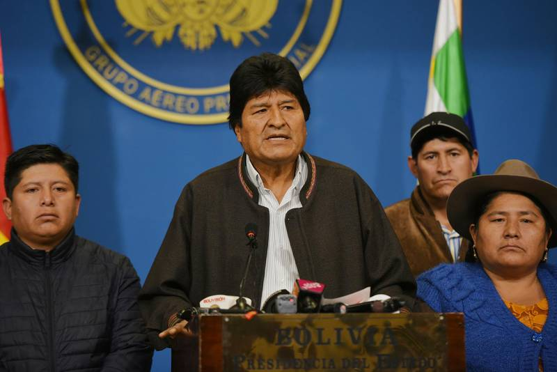 In this photo provided by the Agencia Boliviana de Informacion, Bolivian President Evo Morales speaks from the the presidential hangar in El Alto, Bolivia, Sunday, Nov. 10, 2019. Bolivia's military chief Gen. Williams Kaliman said that President Evo Morales should resign so that stability can be restored after weeks of protests over his disputed election. He stepped in after Morales agreed earlier in the day to hold a new election. (Enzo De Luca/Agencia Boliviana de Informacion via AP)