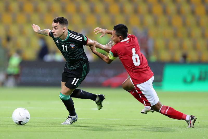Caio Canedo of the UAE battles with Evan Dimas Darmono of Indonesia during the game between the UAE and Indonesia in the World cup qualifiers at the Zabeel Stadium, Dubai on June 11th, 2021. Chris Whiteoak / The National.  Reporter: John McAuley for Sport