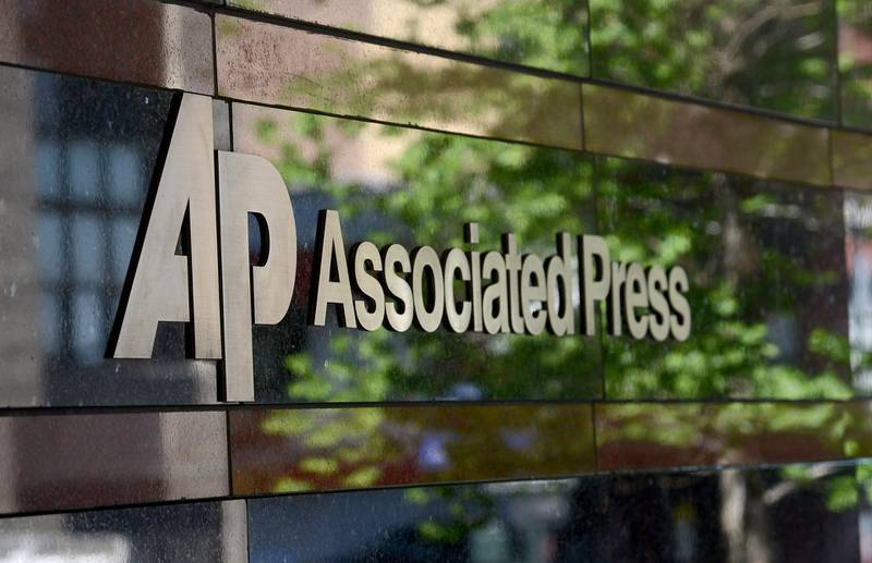 epa03751904 (FILE) A file photo dated 14 May 2013 showing the The Associated Press (AP) logo and company name at the entrance to their office building in New York, New York. The Associated Press on 19 June 2013 reported Pruitt as saying the US Justice Department did not notify Associated Press and acted against its own regulations while conducting an operation whereby it obtained information on telephone calls from and to the company journalists.  EPA/ANDREW GOMBERT
