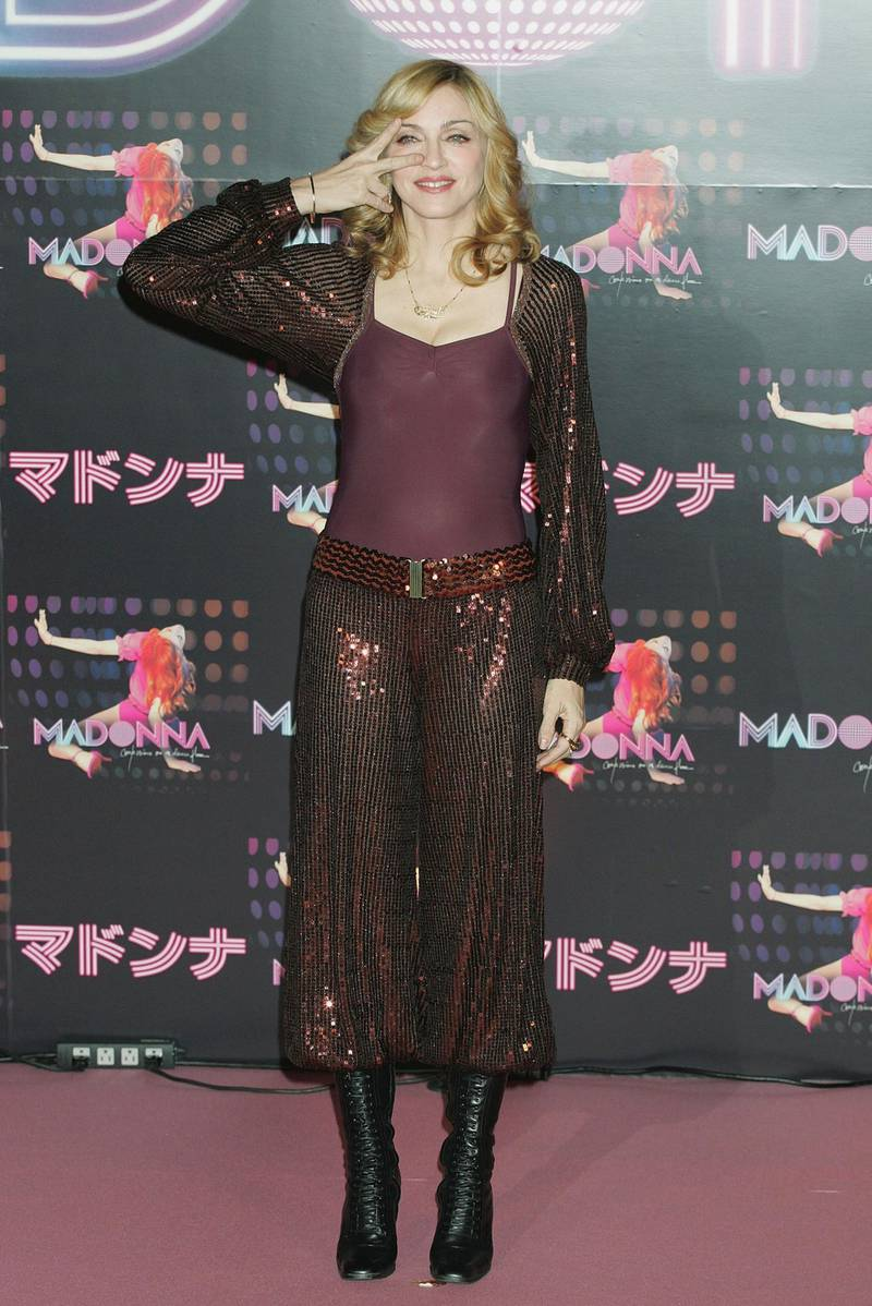 """TOKYO, JAPAN - DECEMBER 7: (INTERNET OUT, WIRELESS OUT) Singer Madonna poses for photographers during a press conference on December 7, 2005 in Tokyo, Japan. She is in Japan to promote her new album """"'Confessions On A Dance Floor"""". (Photo by Junko Kimura/Getty Images)"""