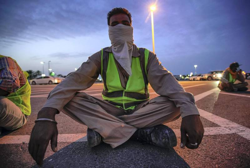 Abu Dhabi, United Arab Emirates, March 27, 2020.     Sanitation workers from Tadweer get ready on the first day of the UAE cleaning campaign.  Emiratis and residents across the UAE must stay home this weekend while a nationwide cleaning and sterilisation drive is carried out.Victor Besa / The NationalSection:  NAReporter:  Haneen Dajani