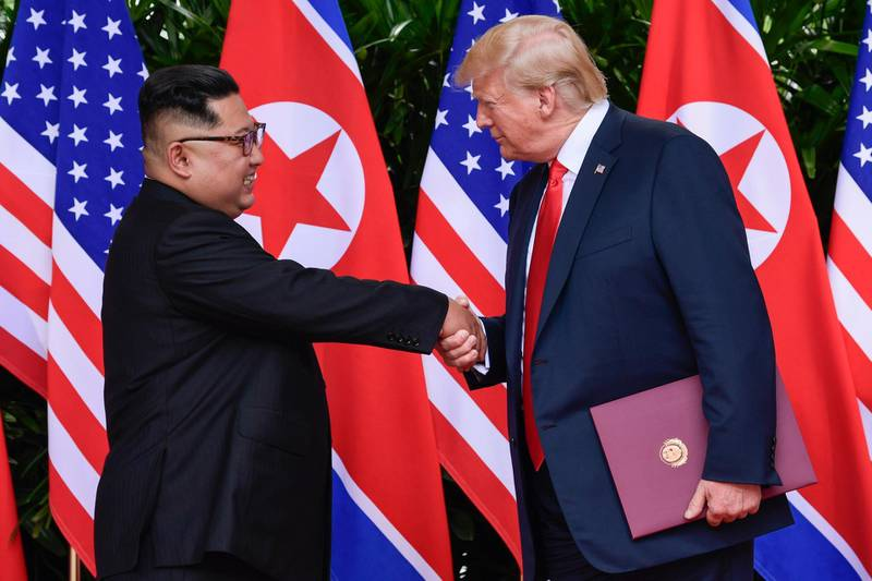 FILE - In this June 12, 2018, file photo, North Korea leader Kim Jong Un, left, and U.S. President Donald Trump shake hands at the conclusion of their meetings at the Capella resort on Sentosa Island in Singapore. Three weeks after the U.S.-North Korea summit and ahead of an impending trip to North Korea by U.S. Secretary of State Mike Pompeo, a leaked U.S. intelligence report and an analysis of satellite data suggest the North may be continuing its nuclear and missile activities despite a pledge to denuclearize. (AP Photo/Susan Walsh, Pool, File)