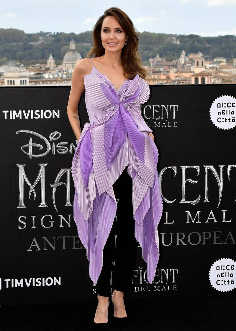 epa07903318 US actress Angelina Jolie poses for the media during a photocall for 'Maleficent: Mistress of Evil' (Italian title: Maleficent: Signora del male) in Rome, Italy, 07 October 2019. The movie opens in Italian theaters on 17 October 2019.  EPA-EFE/ETTORE FERRARI