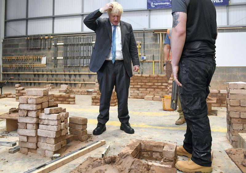 """EXETER, ENGLAND - SEPTEMBER 29: British Prime Minister Boris Johnson during his visit to Exeter College on September 29, 2020 in Exeter, England. In a bid to mitigate rising unemployment due to the Covid-19 pandemic, the Prime Minister announced that adults without an A-level or equivalent qualification will receive a free college course. The offer will be available starting April 2021 and applies to courses teaching """"skills valued by employers."""" (Photo by Finnbarr Webster/Getty Images)"""