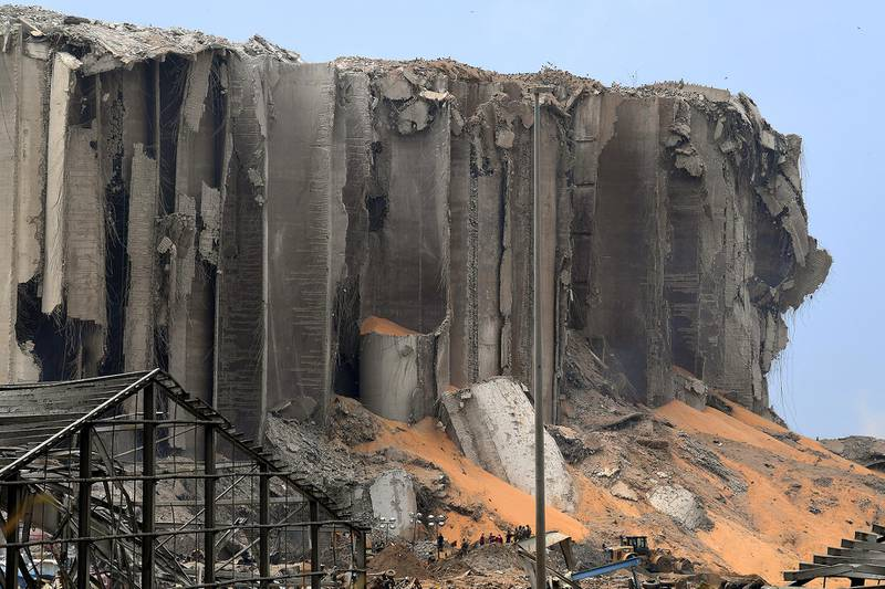 A picture taken on August 7, 2020, shows a view of destroyed grain silos in the port of Beirut, the site of a massive blast which shook the Lebanese capital. - Three days after the monster explosion that disfigured the city in a matter of seconds, the clock was already ticking down on any potential survivors' chances, as rescuers from Lebanon, France, Germany, Russia and other countries worked shifts to try to find an entrance to a control room buried under metres (yards) of rubble. (Photo by - / AFP)