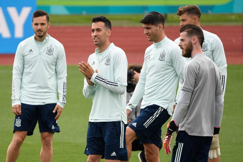 Spain's midfielder Sergio Busquets (2L), Spain's forward Alvaro Morata (3R) and teammates take part in their MD-1 training session at Las Rozas near Madrid on June 22, 2021, the eve of their UEFA EURO 2020 Group E football match against Slovakia. / AFP / PIERRE-PHILIPPE MARCOU
