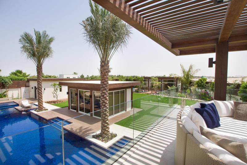 A refurbished six-bedroom Bromellia villa in Dubai's Al Barari development has gone on the market for Dh49m. The 19,000 sq ft property comes with eight bedrooms, six walk-in closets, a view of the Burj Khalifa, parking for five cars, private gym (with accompanying steam room and Jacuzzi)  and a luxury infinity pool. Courtesy of Luxhabitat *** Local Caption ***  bz13no-property-07.jpg bz13no-property-07.jpg